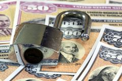 United States Savings Bonds with padlock - Financial security concept Stock Photo