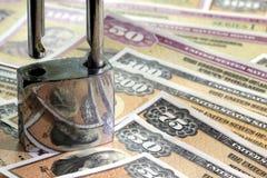 United States Savings Bonds with padlock - Financial security concept Stock Photos