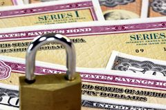 United States Savings Bonds with padlock - Financial security concept Royalty Free Stock Photo