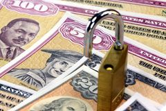 United States Savings Bonds with padlock - Financial security concept Stock Photography