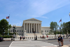 United States Supreme Court building. The Supreme Court building in Washington, DC, with pedestrian traffic royalty free stock photography