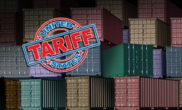 United States Tariff. As a stamp on imported cargo freight background as an economic trade taxation dispute over international import and exports concept as a Royalty Free Stock Images