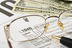 United States Tax Form. Dollars and eyeglasses royalty free stock images