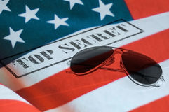 United states top secret. Top secret stamp with sunglasses and United states flag Stock Photo