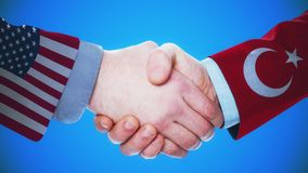 United States - Turkey / Handshake concept animation about countries and politics / With matte channel. Handshaking of the men wearing flag pattern suit 4K stock video