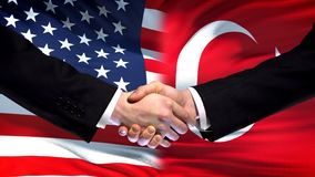 United States and Turkey handshake, international friendship, flag background. Stock photo royalty free stock image