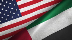 United States and United Arab Emirates two flags textile cloth, fabric texture. United States and United Arab Emirates flags together textile cloth, fabric stock photo