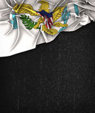 United States Virgin Islands flaggatappning på en svart tavla för Grungesvart royaltyfri fotografi