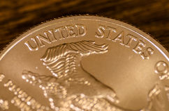 United States (words) on American Gold Eagle Coin.  royalty free stock image