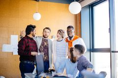 United team members are making plans for weekends. In the office with panorama window Royalty Free Stock Photography