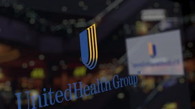 UnitedHealth Group logo on the glass against blurred business center. Editorial 3D rendering Royalty Free Stock Photography