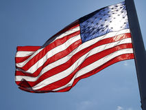 Unites States Flag Streaming With Sun Behind It Stock Images
