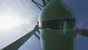 Unitruck drives along overpass way under sky low angle shot. Light green unitruck vehicle drives along overpass railway under blue sky at testing ground low stock video