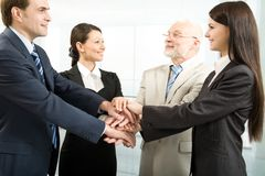 Unity. Business people joining their hands Stock Image