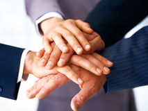 Unity. Closeup of business people's hands making a pile against a white background Stock Photo