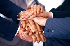 Unity. Closeup of business people's hands making a pile against a white background Royalty Free Stock Image