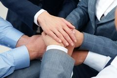 Unity. Image of business people hands on top of each other symbolizing support and power Stock Photo