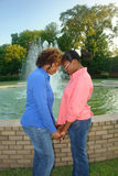 Unity. A picture of a portrait of mother and daughter showing unity by water fountain Royalty Free Stock Photo