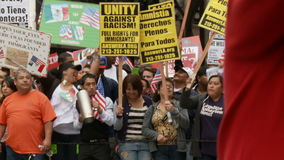 `UNITY AGAINST RACISM` Rally. People jumping and chanting in Spanish with banners during a rally for the Occupy Movement in Downtown Los Angeles, California on stock video footage