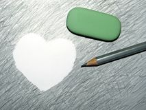 Unity of antipodal forces. pencil and eraser. The heart is a symbol of love stock photography