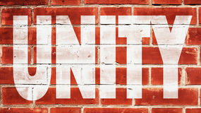 Unity On A Brick Wall. Unity Written On A Brick Wall Royalty Free Stock Image