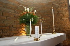 Unity candle. And flowers on altar at a wedding stock images