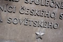 Unity of Czech and Soviet nation. Historic memorial and monument is mentioning unity of Czech a Soviet nation. Socialist and Communist star under text.Surface Stock Image