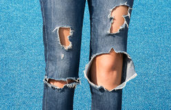 Unity in diversity. Female legs in Perforated blue royalty free stock image