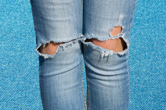 Unity in diversity. Female legs in Perforated blue royalty free stock photography
