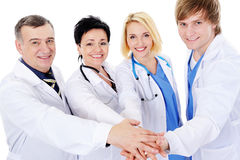 Unity of four happy successful doctors Stock Photography