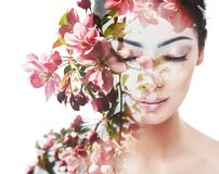 Unity of human with nature, beauty of youth and femininity. Double exposure portrait of young pretty woman combined with bright spring garden flowers royalty free stock photography