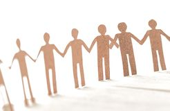 Unity of paper human team work. On white background Royalty Free Stock Images