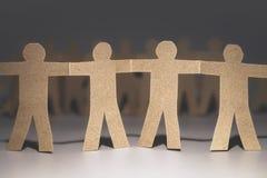 Unity of paper team. Symbol royalty free stock photo