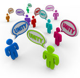 Unity - People Talking in Speech Bubbles Teamwork. Many people talking at the same time, pledging allegiance to the group by speaking the word Unity Stock Images