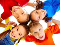 Unity. Portrait of adorable schoolkids touching their heads and looking at camera Stock Photo