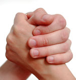 Unity and struggle. Female and man's hand compressed together stock image