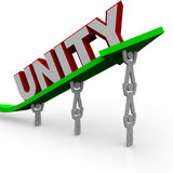 Unity - Team Works Together. A team of people work together to lift an arrow rising up, symbolizing cooperation and successful group effort Royalty Free Stock Photography