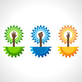Unity ,victory and helping hand make tree on gear Stock Photos