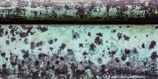 A beautiful aged texture of metal covered with peeling and weathered turquoise paint. With spots of rust. Universal background. Space for text stock image