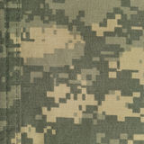 Universal camouflage pattern, army combat uniform digital camo, double thread seam, USA military ACU macro closeup,rip-stop fabric Stock Images