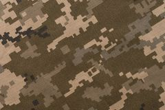Universal camouflage pattern army combat uniform digital camo. Top view Royalty Free Stock Photo