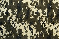 Universal camouflage pattern. Universal camouflage pattern, army combat uniform digital camo Royalty Free Stock Photography