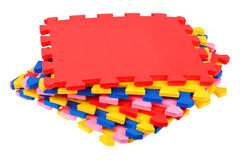 Universal carpet. Color prefabricated parts universal carpet. A white background Stock Photo