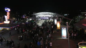Universal Citywalk Orlando at night. Orlando, USA - March 20, 2016: Locals and tourists crowd into Universal Citywalk in Orlando, a popular nightlife hotspot stock video