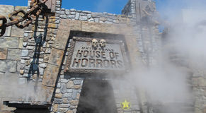Universal House of Horrors. Universal Studios in California. Hollywood. The entrance to the house of horrors with smoke and fog. Universal Studios in California royalty free stock photography