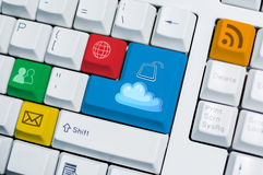 Universal internet symbol keyboard with cloud unlock button Royalty Free Stock Images
