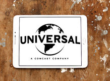 Universal logo. Logo of the american film and television production company universal on samsung tablet on wooden background Royalty Free Stock Photos
