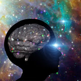 Universal Mind. Brain inside silhouette of human head with stars Royalty Free Stock Photo