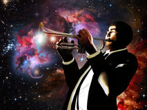 Universal music. A trumpeter plays his music. From the trumpet are coming out stars and galaxies, creating  the universe around the musician Stock Photo