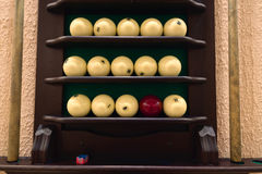 Universal rack of billiard balls and cues. Stock Photography